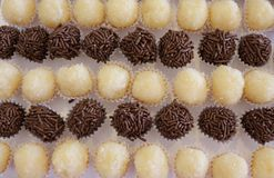 Brazilian party candy as know as brigadeiro. Made with sweet condensed milk and cocoa powder. And its white version royalty free stock photos