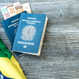 Brazilian passaport, flag and money Stock Photos