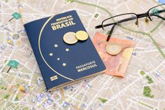 Brazilian passport, euros, glasses and map for travel abroad. Passport, euros, glasses and map for travel abroad. Brazilian passport and map of the city of Royalty Free Stock Images
