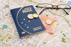 Brazilian passport, euros, glasses and map for travel abroad. Passport, euros, glasses and map for travel abroad. Brazilian passport and map of the city of Royalty Free Stock Photos