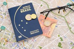 Brazilian passport, euros, glasses and map for travel abroad. Passport, euros, glasses and map for travel abroad. Brazilian passport and map of the city of royalty free stock photography