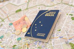 Brazilian passport, euros and map for travel abroad. Passport, euros and map for travel abroad. Brazilian passport and map of the city of Porto in Portugal Royalty Free Stock Image