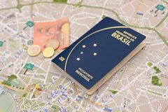 Brazilian passport, euros and map for travel abroad. Passport, euros and map for travel abroad. Brazilian passport and map of the city of Porto in Portugal Stock Photography