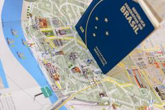 Brazilian passport and map for travel abroad. Brazilian passport and map of the city of Porto in Portugal Stock Images
