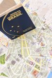 Brazilian passport and map for travel abroad. Brazilian passport and map of the city of Porto in Portugal Royalty Free Stock Photo