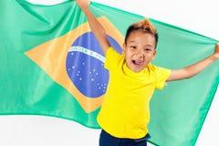 Brazilian patriot boy holding Brazil flag. Football or soccer championship Royalty Free Stock Photography