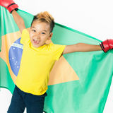 Brazilian patriot boy holding Brazil flag. Football or soccer championship Royalty Free Stock Photos
