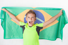 Brazilian patriot boy holding Brazil flag. Football or soccer championship Royalty Free Stock Images