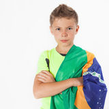 Brazilian patriot boy holding Brazil flag. Football or soccer championship Stock Images