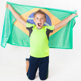 Brazilian patriot boy holding Brazil flag. Football or soccer championship Stock Photo