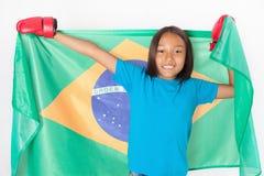 Brazilian patriot, fan girl holding Brazil flag. Brazilian boxing championship. Royalty Free Stock Photography