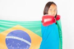 Brazilian patriot, fan girl holding Brazil flag. Brazilian boxing championship. Stock Photography