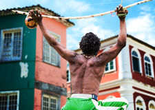 Brazilian performing Capoeira with Berimbau Instrument in Bahia Stock Image