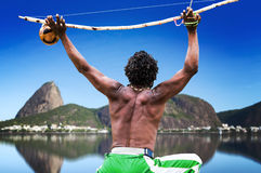 Brazilian performing Capoeira with Berimbau Instrument in Rio de Janeiro Stock Photography