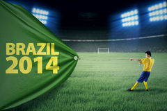 Brazilian player pulling a banner of championship Royalty Free Stock Image