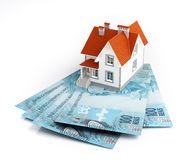 Brazilian real banknotes under house Stock Photo