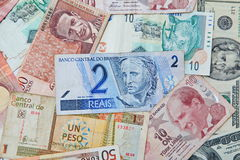 Brazilian real in the middle. Background from paper money of the different countries. Brazilian real in the middle Stock Photo
