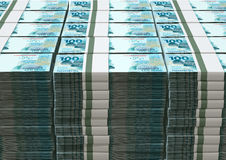 Brazilian real notes. A pile of wads of brazilian real banknotes on an isolated background Stock Photography