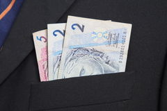 Brazilian Real in the pocket of a suit. Close up Stock Images