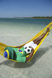 Brazilian Relaxing with Soccer Football in Beach Hammock Royalty Free Stock Photo