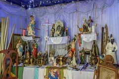 Brazilian religious altar mixing elements of umbanda, candomblé and catholicism. In the syncretism present in the local culture and religion stock image