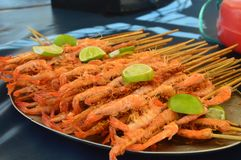 Brazilian shrimp exquisite flavor and aroma. Brazilian shrimp on the seashore, exquisite flavor and aroma, large shrimp, brochettes, atlantic ocean Stock Photography