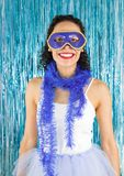 Brazilian smiling and happy. Woman costumed for the Carnival. Bl. Brazilian teenager has a big smile on his face. Woman costumed for the Brazilian Carnival. Blue Stock Image