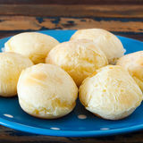 Brazilian snack cheese bread (pao de queijo) on blue plate Stock Photos