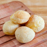 Brazilian snack cheese bread (pao de queijo) on cutting board Stock Images