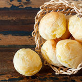 Brazilian snack cheese bread (pao de queijo) in wicker basket Stock Photos