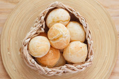 Brazilian snack cheese bread (pao de queijo). In wicker basket on wooden table. Selective focus Royalty Free Stock Photography