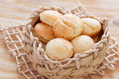 Brazilian snack cheese bread (pao de queijo). In wicker basket on wooden table. Selective focus Stock Photo