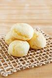 Brazilian snack cheese bread (pao de queijo) on wooden table Royalty Free Stock Photos