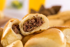 Brazilian snack. Meat Esfiha portion. Stock Photos