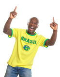 Brazilian soccer fan cheering and pointing Stock Photos