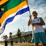 Brazilian soccer fan with national flag Royalty Free Stock Photography