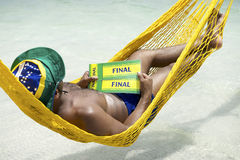 Brazilian Soccer Fan Relaxing with Tickets to Final Stock Photography