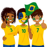 Brazilian Soccer Fans. Young Brazilian soccer fans cheering their Brazil national football team Royalty Free Stock Photos