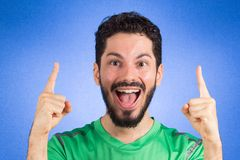 Brazilian soccer football athlete man celebrating. Brazilian soccer football athlete. One supporter and fan celebrating on blue background wearing green uniform royalty free stock images