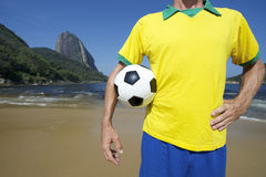 Brazilian Soccer Football Player Standing on Rio Beach Royalty Free Stock Images