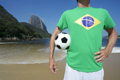 Brazilian Soccer Football Player Standing on Rio Beach Stock Photo