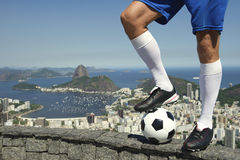 Brazilian Soccer Football Player Standing At Rio Skyline Royalty Free Stock Image