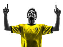 Brazilian soccer football player young happiness joy man silhoue Stock Photos