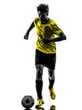 Brazilian soccer football player young man silhouette. One brazilian soccer football player young man in silhouette studio  on white background Stock Photography