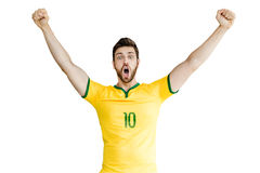 Brazilian soccer player celebrates on white background Royalty Free Stock Photos