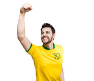 Brazilian soccer player celebrates on white background Stock Photos