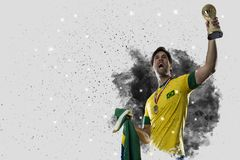 Brazilian soccer player coming out of a blast of smoke. celebrat Stock Photos