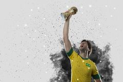 Brazilian soccer player coming out of a blast of smoke. celebrat Royalty Free Stock Image