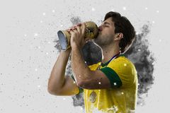 Brazilian soccer player coming out of a blast of smoke. celebrat Royalty Free Stock Photo
