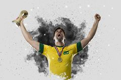 Brazilian soccer player coming out of a blast of smoke. celebrat Stock Photo